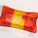 Among our interesting glass offerings, this sure to brighten any table butter dish by Carol Lehr. $35.