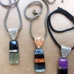 Fused glass pendants designed by Gila Sagy